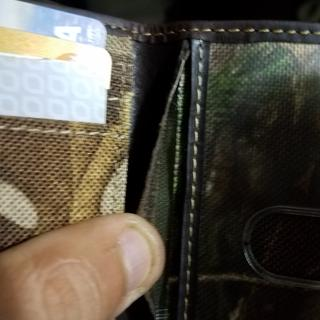The leather peeling back exposing the inards of the wallet