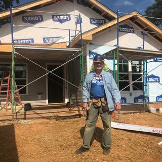 At a Habitat for Humanity build site with new Carhartt shirt and old Carhartt pants.
