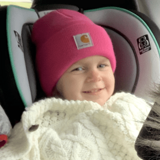 Enjoying a car ride in her new Carhartt gear.