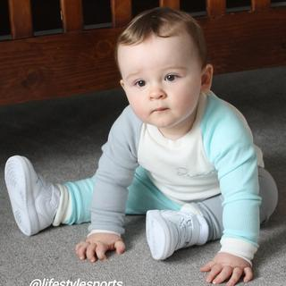 My little boy showing off his cool new trainers for his 1st birthday